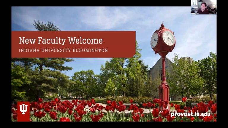 screenshot says new faculty welcome while showing red tulips and a campus clock
