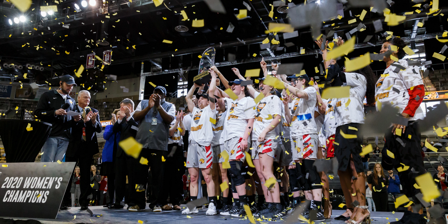 Confetti falls on the IUPUI women's basketball team after winning the Horizon League Tournament