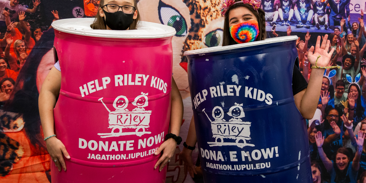 Two students dressed up as Jagathon donation cans.