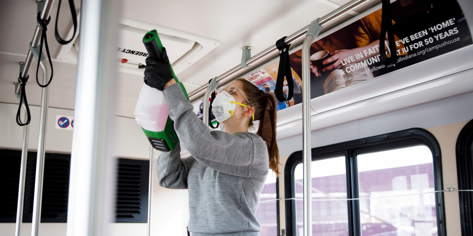 A student supervisor at Indiana University Campus Bus cleans a bus