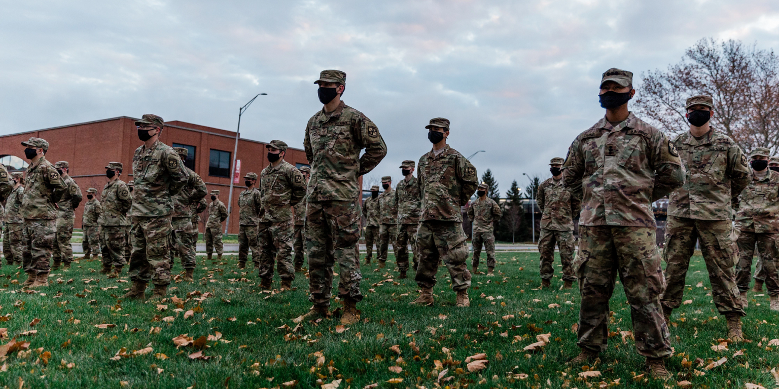 a large group of soldiers stand outside in formation