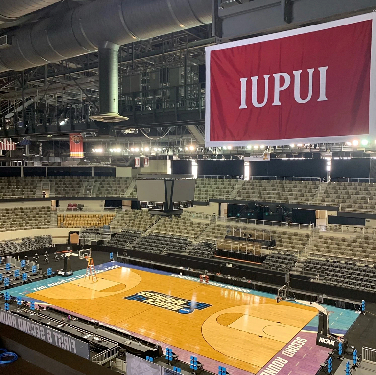 A view from the top of Indiana Farmers Coliseium showing the court and IUPUI flag