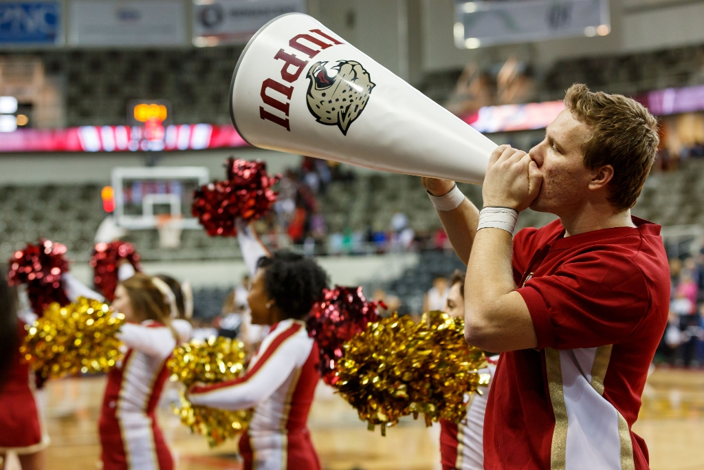 An IUPUI cheerleader riles up the crowd with the help of a megaphone.