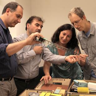 Jacobs professors Giovanni Zanovello, Giuliano Di Bacco and Halina Goldberg inspect the collection with George Lerner.
