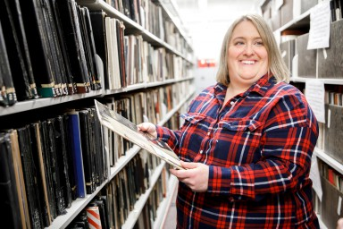 Michelle Hahn holds a record in the William and Gayle Cook Music Library.