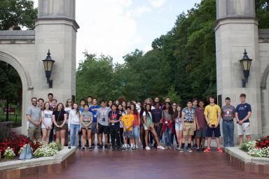 Hoosier Debate Camp group stands in front of IU's Sample Gates
