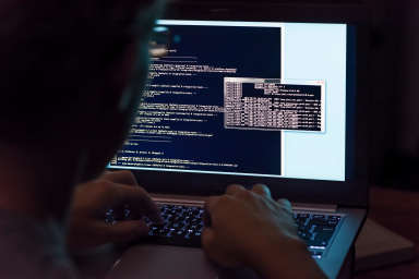 A person coding on a computer