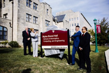 IU officials unveil the sign at the newly renamed Myles Brand Hall
