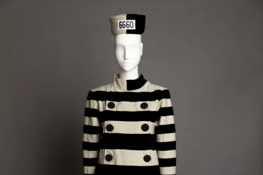Cruella De Vil's prison costume dressed on a mannequin