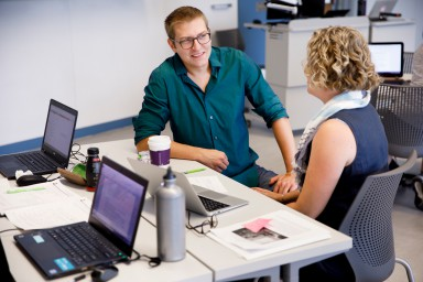 Instructional consultant and media specialist Matt Barton works with an IU faculty member.