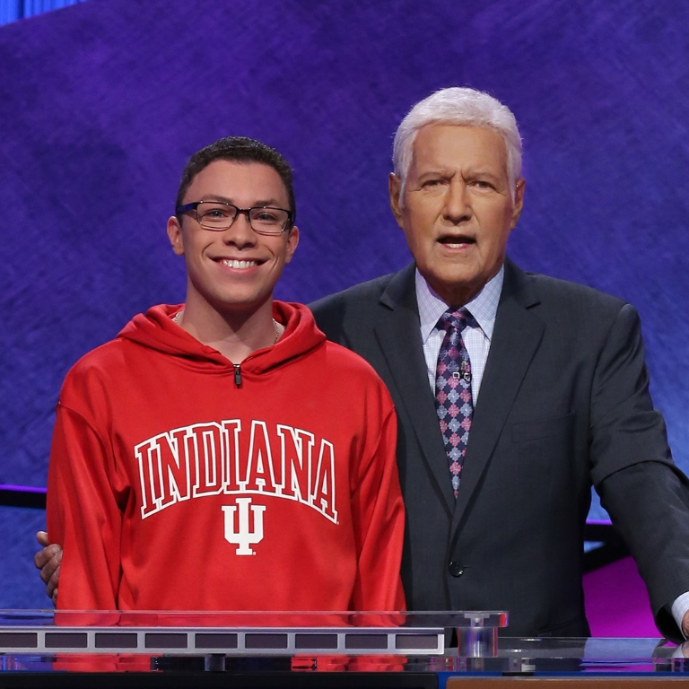 Student Tyler Combs on the set of Jeopardy with host Alex Trebek