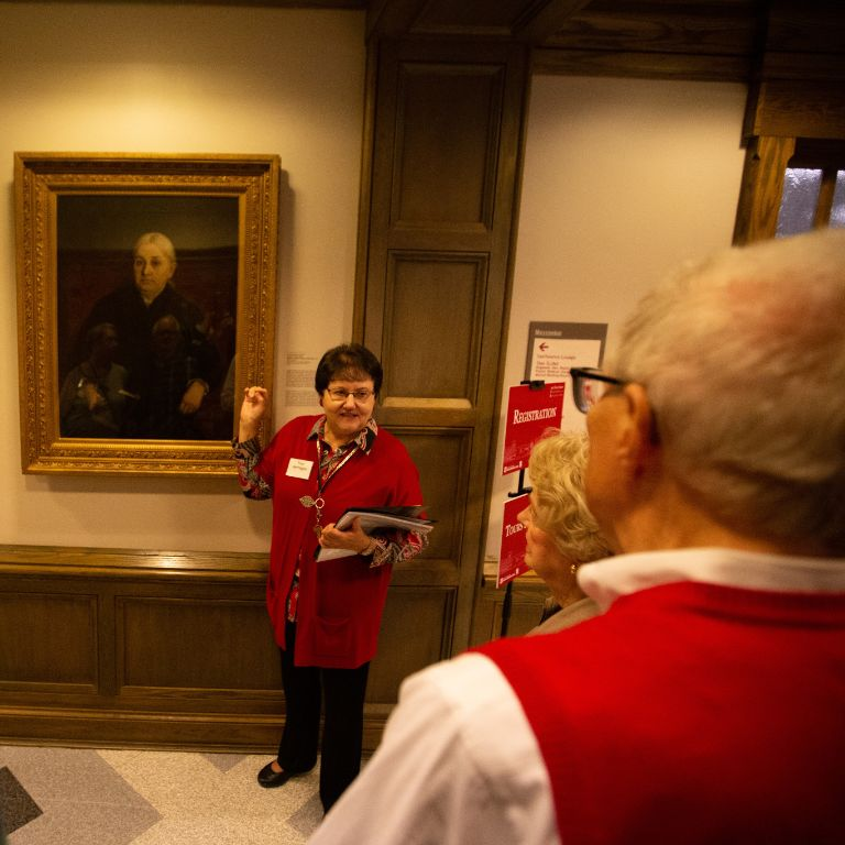 A woman gives a tour of the Indiana Memorial Union