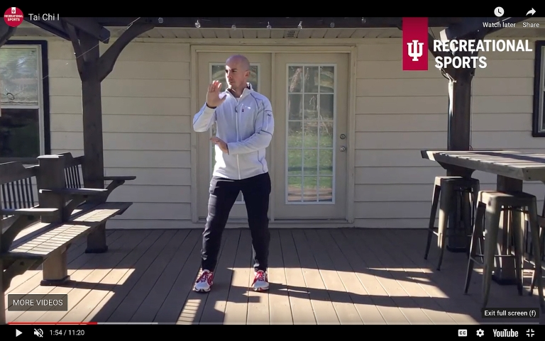 An IU personal trainer performs tai chi on his back patio