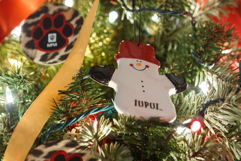 IUPUI snowman ornament hangs on an IUPUI-themed Christmas tree.