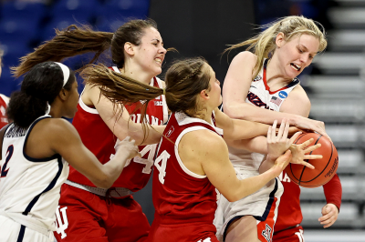 Indiana and Arizona women's basketball players battle for the ball
