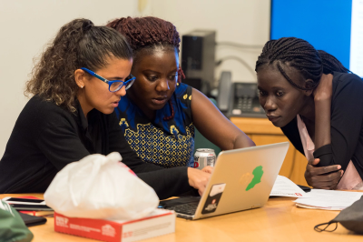Three women looking at a computer