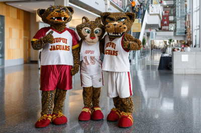 Mascots Jazzy, Jawz and Jinx stand inside the IUPUI Campus Center