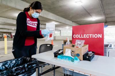 a woman handles mitigation testing inside a parking garage