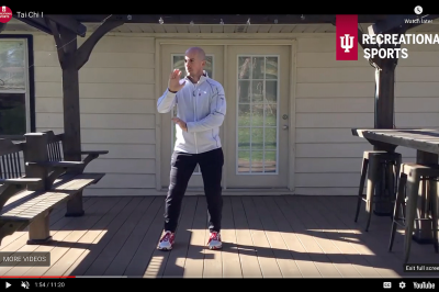 An IU personal trainer performs tai chi on his back patio.