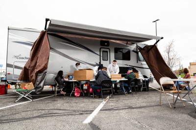 A mobile coronavirus testing site is set up in a parking lot