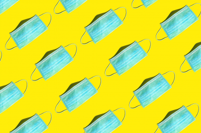 surgical masks on a yellow background