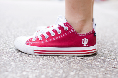 a red sneaker with an IU trident on the side