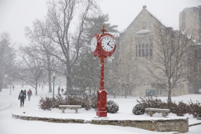 a snowy red clock on the Bloomington campus