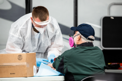 A man is tested for the novel coronavirus at a mobile testing site