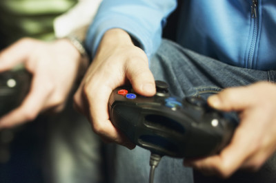 Two hands using a video game controller