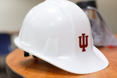 A hard hat with the IU trident on it