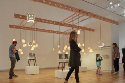 guests walk through an art exhibit