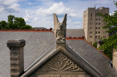 A grotesque sits atop Maxwell Hall on the Bloomington campus