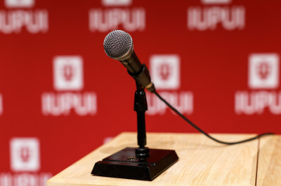 A microphone on a stand in front of an IUPUI background