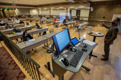Students attend class in the Indiana Memorial Union with safety precautions in place.