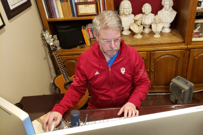 An IU employee works from his home office