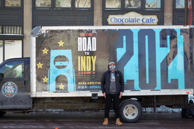 Wally Al-Hamed stands outside a large box truck branded with NCAA Final Four