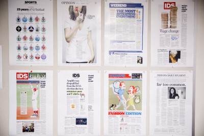 Draft pages of a newspaper on a cork board
