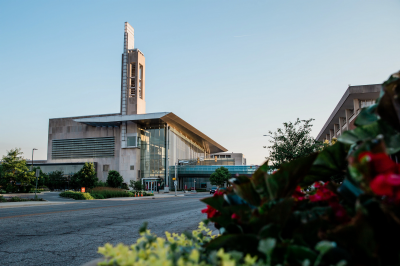 the IUPUI Campus Center framed behind a bed of flowers