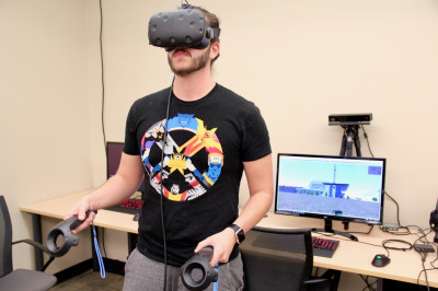 A student looks through a virtual reality headset.