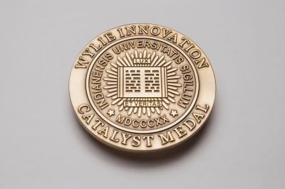 Circular gold medal that reads Wylie Innovation Catalyst Medal