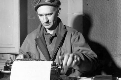 World War II correspondent Ernie Pyle works on a story.