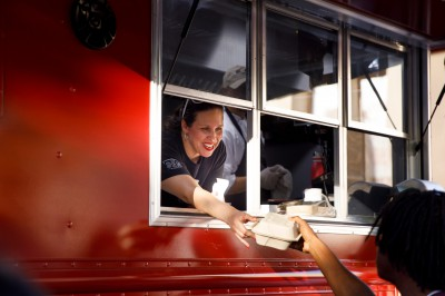A woman leaning out of the IU food truck window