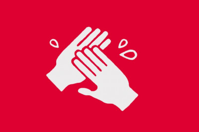 A white icon of hand washing on a red background