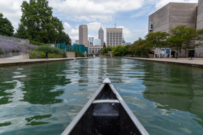 a view from a canoe looking at downtown Indy