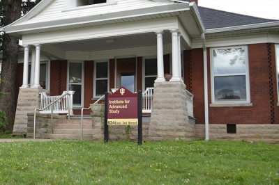 sign reading Institute for Advanced Study in front of a brick house