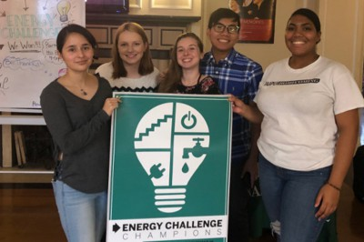 Students hold the Energy Challenge banner.