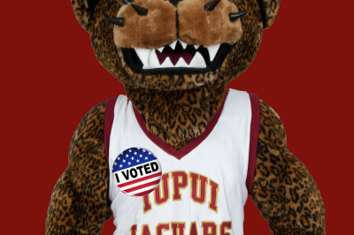 Jawz wearing an 'I voted' sticker on his mascot uniform