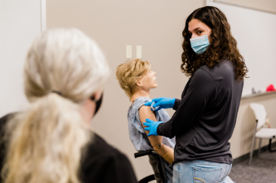 IU medical students participate in training to learn how to administer the COVID-19 vaccine