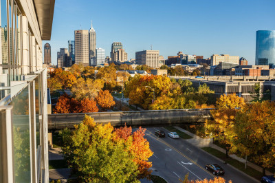 A view of downtown Indianapolis from IUPUI with colorful fall foliage of red, orange and yellow