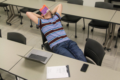 A student takes a break from studying by napping.